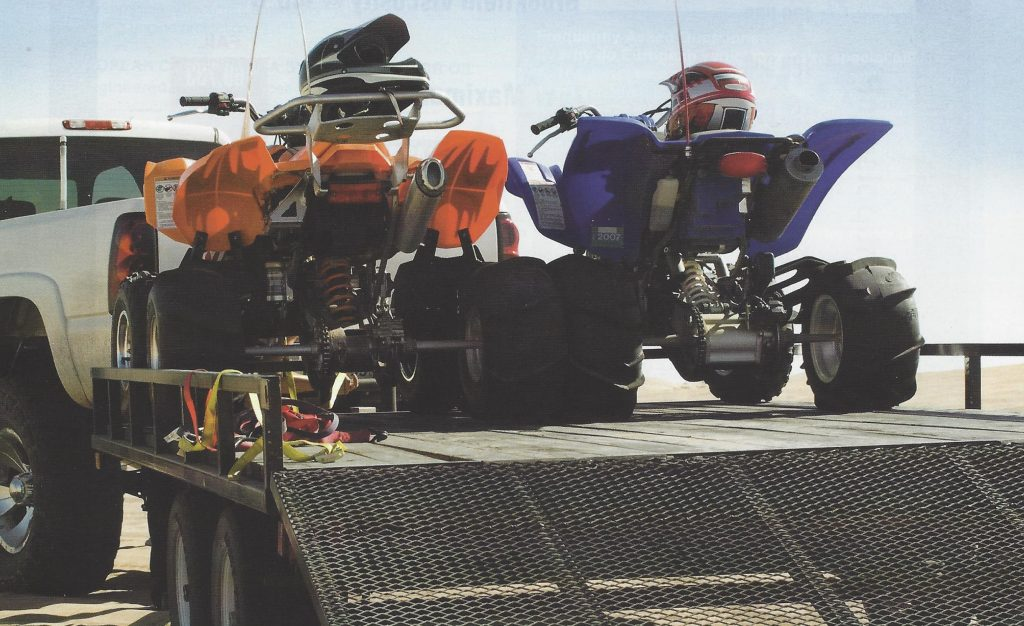 Vehicle with trailer and ATVs.